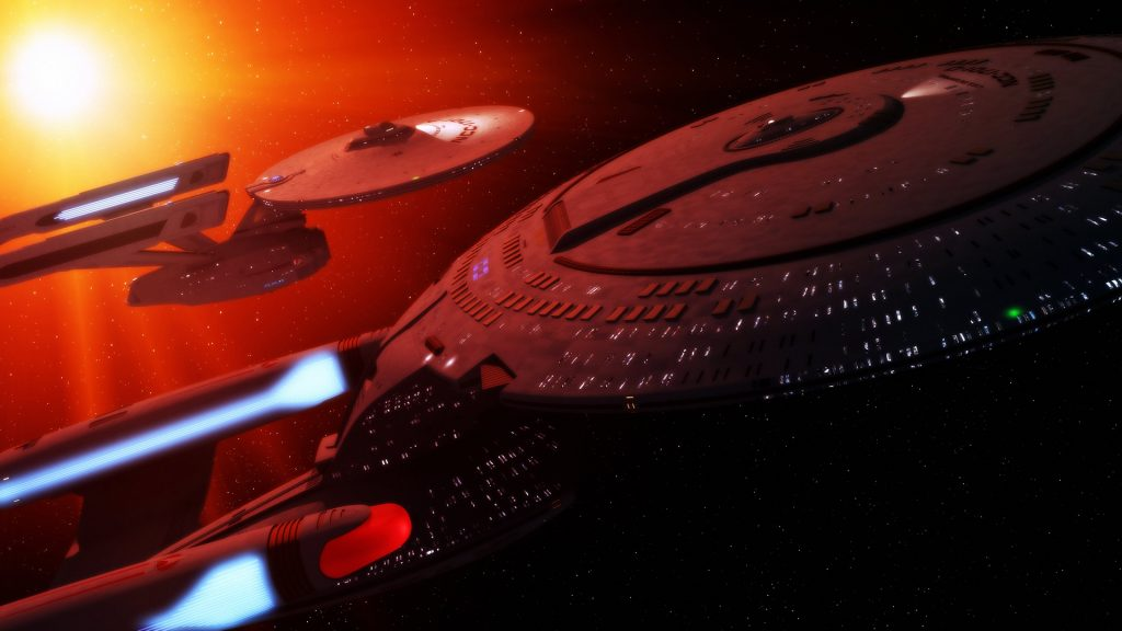 Two starships fly past a star.